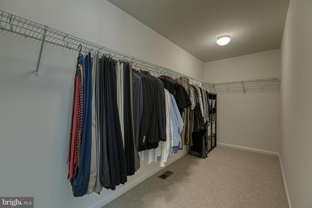 A very large - walk in-master bedroom closet - 332 BOXELDER DR, STAFFORD