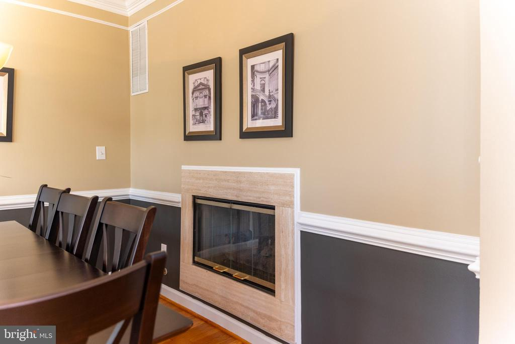 See through fireplace from dining to family room - 1911 LOGAN MANOR DR, RESTON