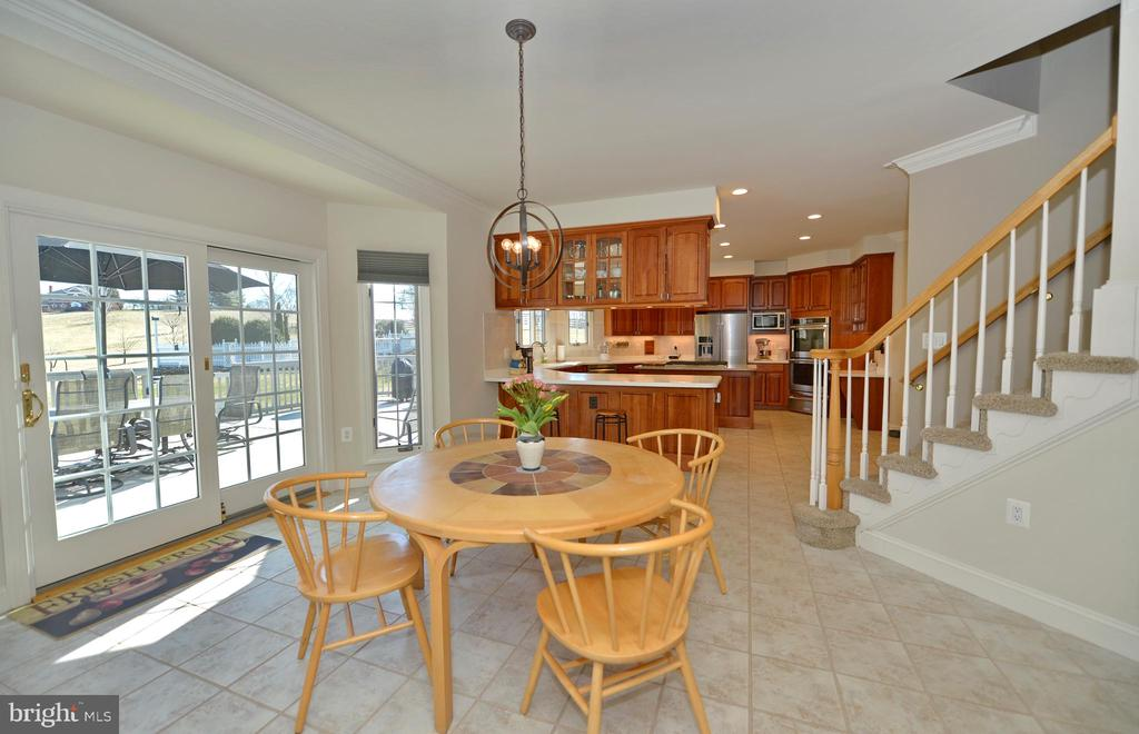 Breakfast room with back staircase to upper level - 16080 GOLD CUP LN, PAEONIAN SPRINGS