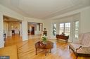 Living room view to foyer and dining room - 16080 GOLD CUP LN, PAEONIAN SPRINGS