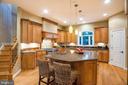 Breakfast Bar. 1 of 2 Sit Down Kitchen Islands - 9110 DARA LN, GREAT FALLS