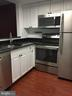 Ktichen - Granite counters & SS appliances - 1951 SAGEWOOD LN #18, RESTON
