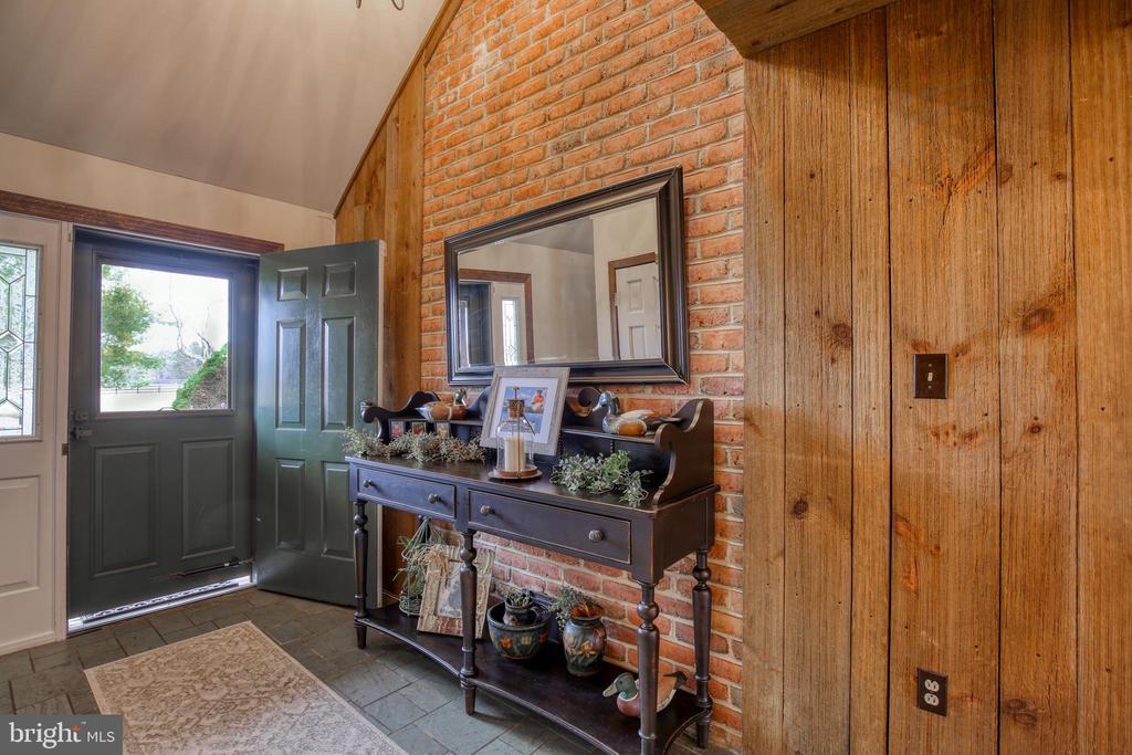 Foyer with slate floor & exposed brick on wall - 2327 GUN BARREL RD, WHITE POST