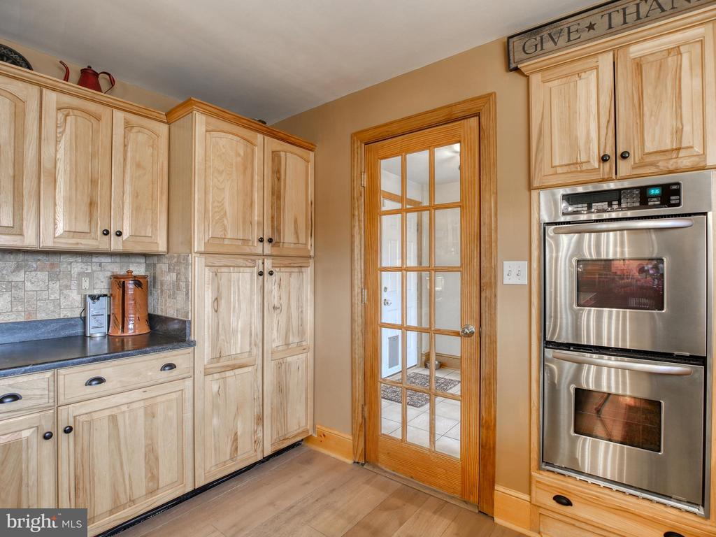 Kitchen opens to laundry room/pantry space - 2327 GUN BARREL RD, WHITE POST