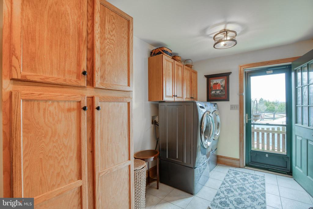 Separate laundry area with ample storage - 2327 GUN BARREL RD, WHITE POST