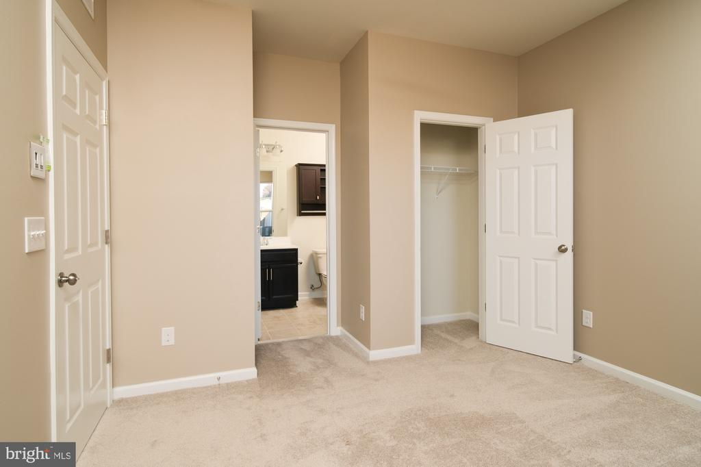 LOWER LEVEL BEDROOM CLOSET AND BATHROOM ENTRY - 45002 GRADUATE TER, ASHBURN
