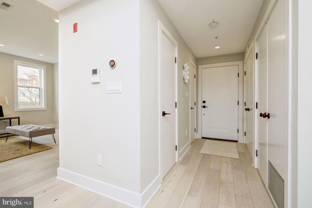 Hallway with coat closet and half bathroom - 1821 I STREET NE #11, WASHINGTON
