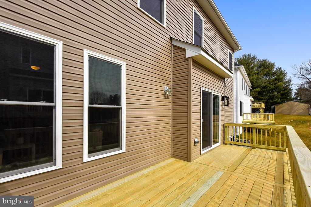 Deck serving the lower level. - 18609 STRAWBERRY KNOLL RD, GAITHERSBURG