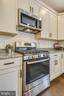 Gas range and built-in microwave. - 18609 STRAWBERRY KNOLL RD, GAITHERSBURG