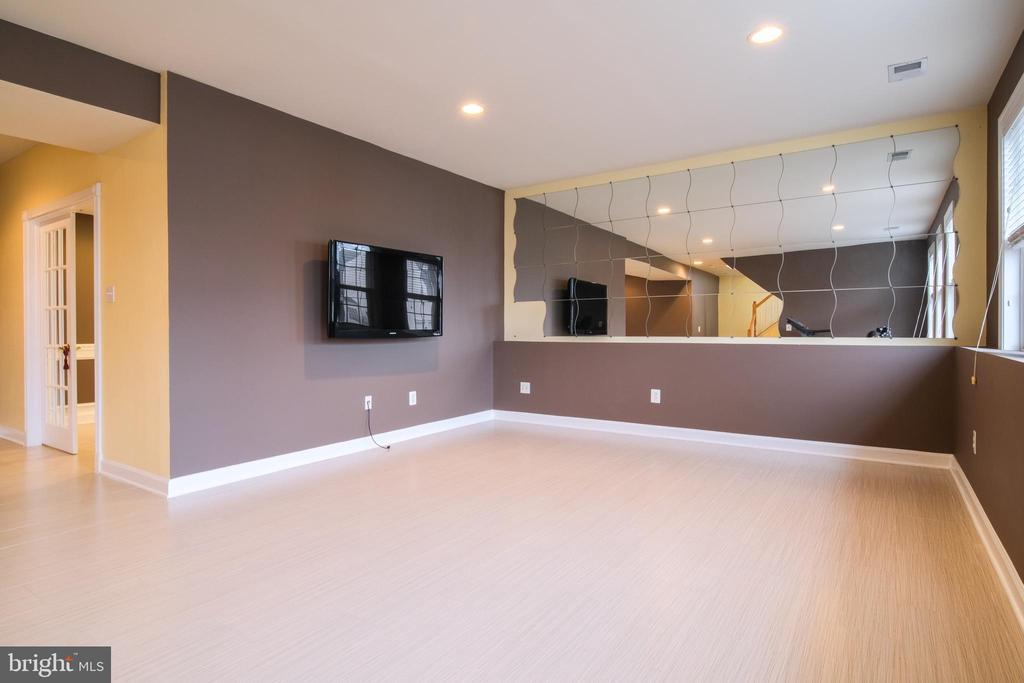 Basement with new floor tiles - 13299 SCOTCH RUN CT, CENTREVILLE