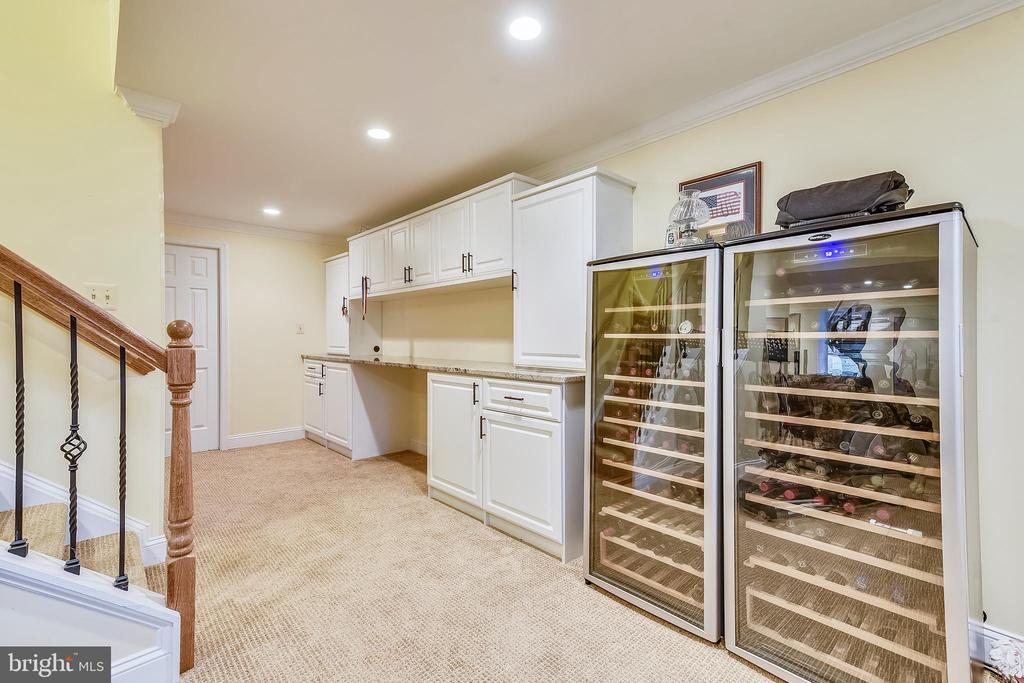Built in desk with granite counter in the rec room - 12400 FAIRFAX STATION RD, CLIFTON