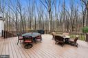 Deck off the sunroom with a gas firepit - 12400 FAIRFAX STATION RD, CLIFTON