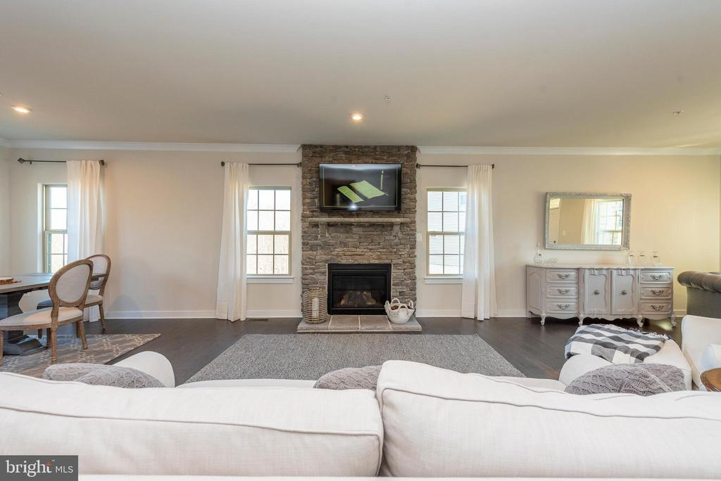 Living room with stone fireplace - 9689 AMELIA CT, NEW MARKET