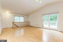 Living Room with access to large deck - 12901 JESSE SMITH RD, MOUNT AIRY