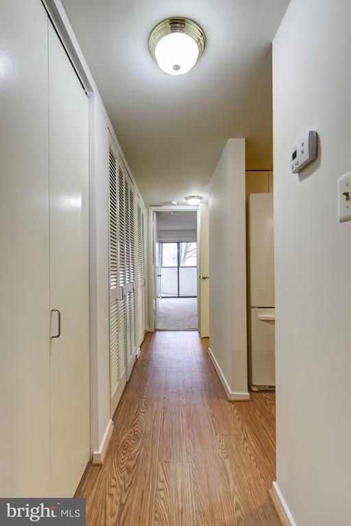 Hallway with lovely floors! - 1951 SAGEWOOD LN #203, RESTON