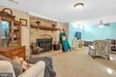 Handsome brick fireplace  with wood stove - 9 BROOKMEADE CT, STERLING