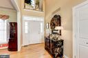 View of the front door with two story foyer - 2407 FLAG MARSH RD, MOUNT AIRY
