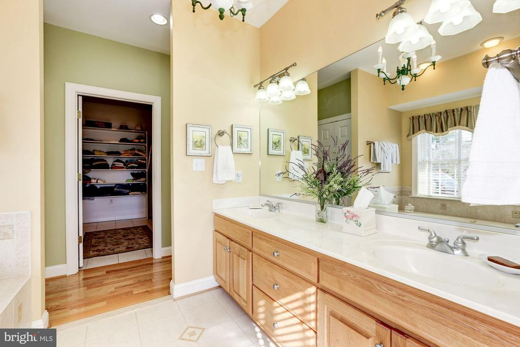 Main level owner's bathroom with two sinks - 2407 FLAG MARSH RD, MOUNT AIRY
