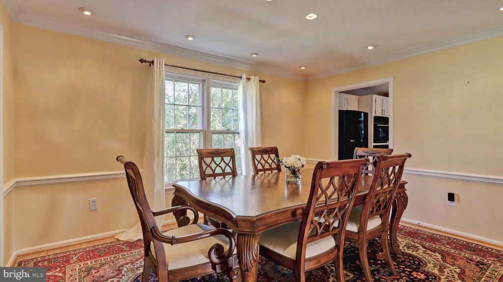 Dining room with recessed lightning... - 7504 GLENNON DR, BETHESDA
