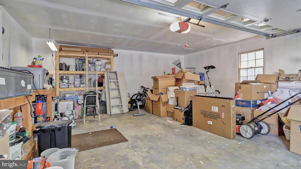 Two car garage with extra storage area... - 7504 GLENNON DR, BETHESDA
