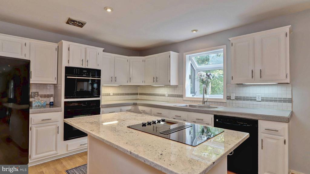 Updated quartz island with new cooktop... - 7504 GLENNON DR, BETHESDA