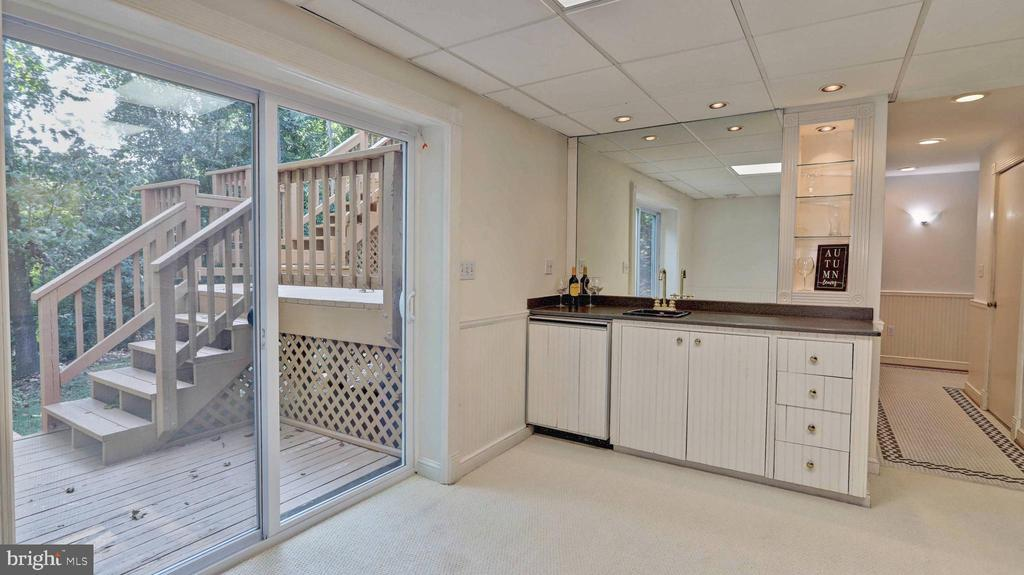 Recreation room with access to lower deck level... - 7504 GLENNON DR, BETHESDA