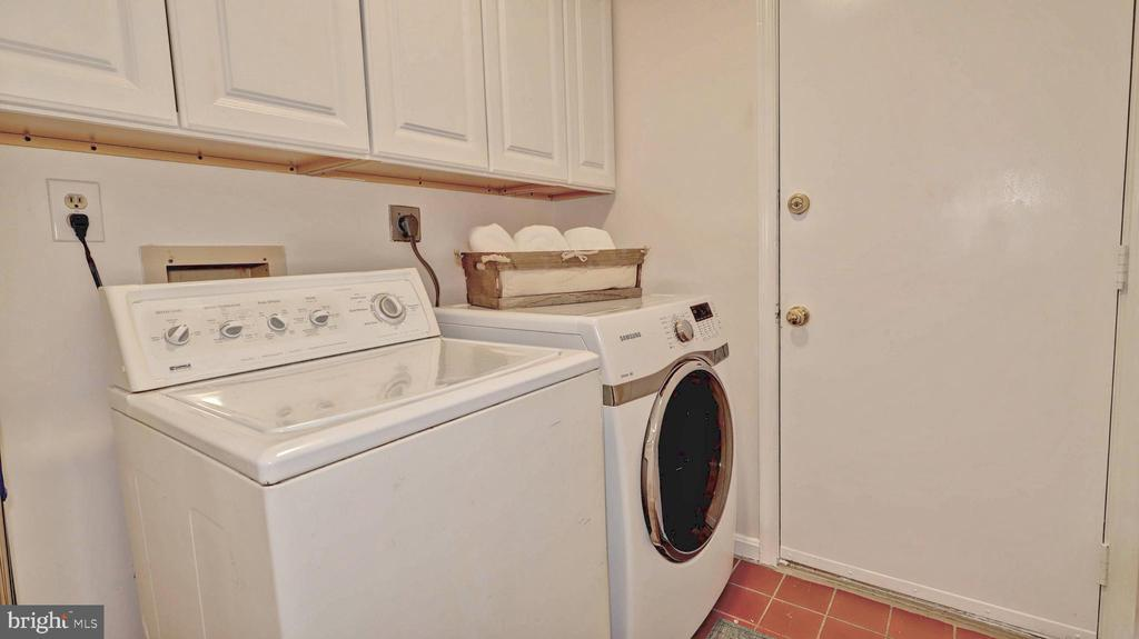 Laundry room with garage access... - 7504 GLENNON DR, BETHESDA