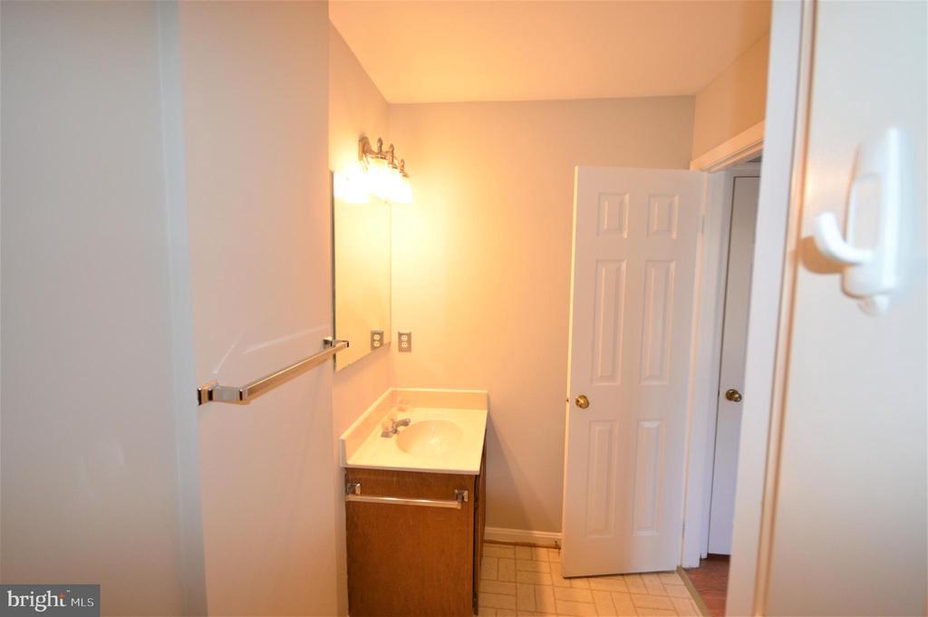 There's a full bath on all three floors. - 6490 BRICK HEARTH CT, ALEXANDRIA