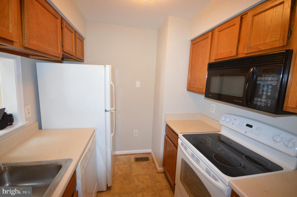 Efficiency kitchen with additional pantry space. - 6490 BRICK HEARTH CT, ALEXANDRIA