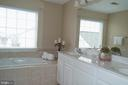 bathroom has double sinks, soaking tub & shower. - 134 BRADDOCK ST, CHARLES TOWN