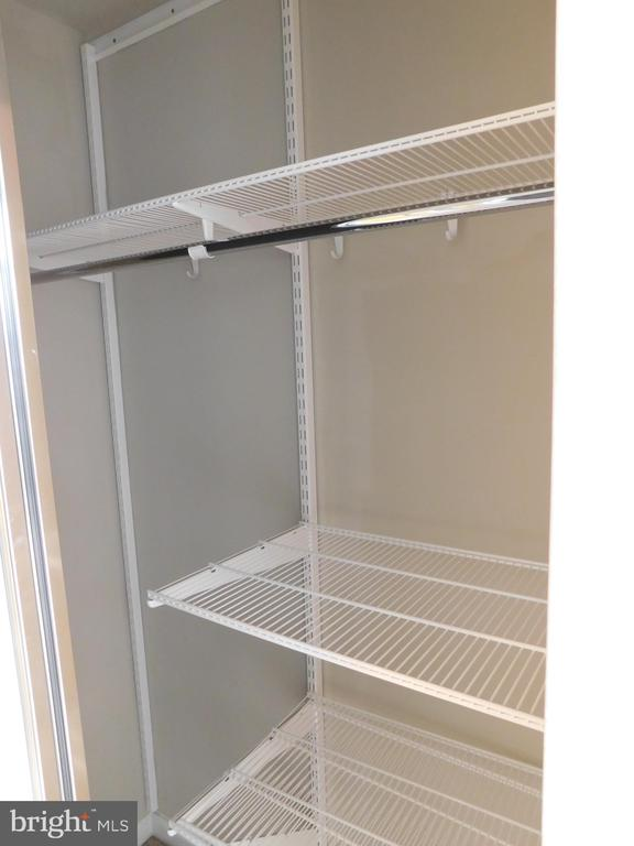 Both Closets in Bedroom with shelves - 11700 OLD GEORGETOWN RD #314, NORTH BETHESDA