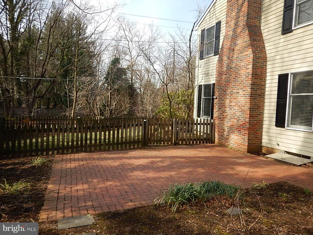 Brick patio to the side of the front porch - 1510 BOYCE AVE, TOWSON