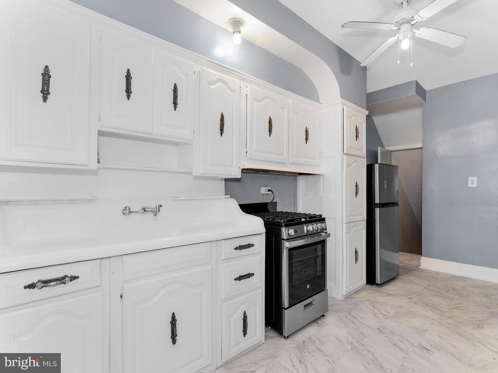 Kitchen.  New range and refrigerator. - 438 INGRAHAM ST NW, WASHINGTON