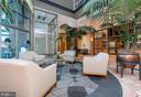 Atrium lobby with access to Harbor Promenade. - 2901 BOSTON ST #214, BALTIMORE