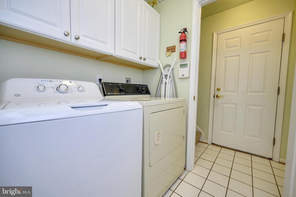 Laundry room with cabinetry. - 509 MT PLEASANT DR, LOCUST GROVE