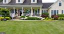 Landscaping along front of home in the  Spring - 2407 FLAG MARSH RD, MOUNT AIRY