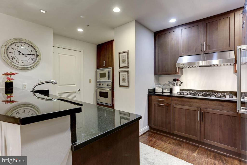 Gourmet kitchen view to laundry room - 2501 WISCONSIN AVE NW #104, WASHINGTON