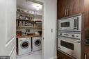 Laundry room with washer/dryer off kitchen - 2501 WISCONSIN AVE NW #104, WASHINGTON