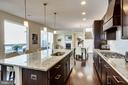 Endless espresso cabinets and granite counters - 44536 STEPNEY DR, ASHBURN