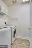 Efficient and large laundry room on upper level - 44536 STEPNEY DR, ASHBURN