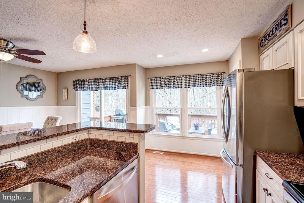 Kitchen is Lined with a Wall of Windows; SO SUNNY! - 1614 OAK SPRING WAY, RESTON