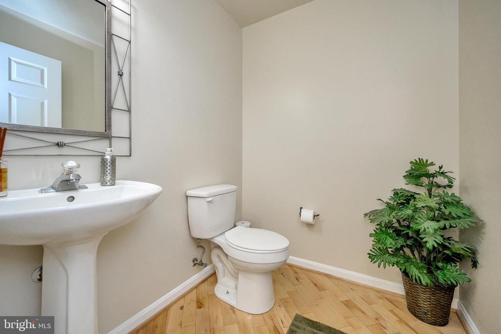 Beautiful hardwood floors in half bath. - 200 SAND TRAP LN, LOCUST GROVE