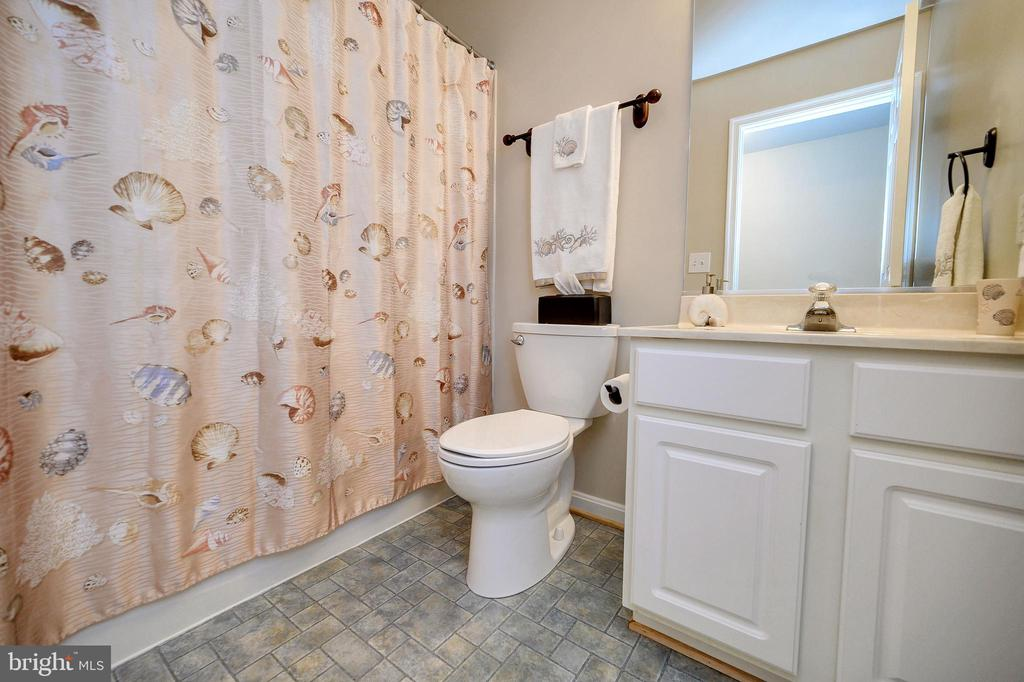Bathroom in basement perfect for guests. - 200 SAND TRAP LN, LOCUST GROVE