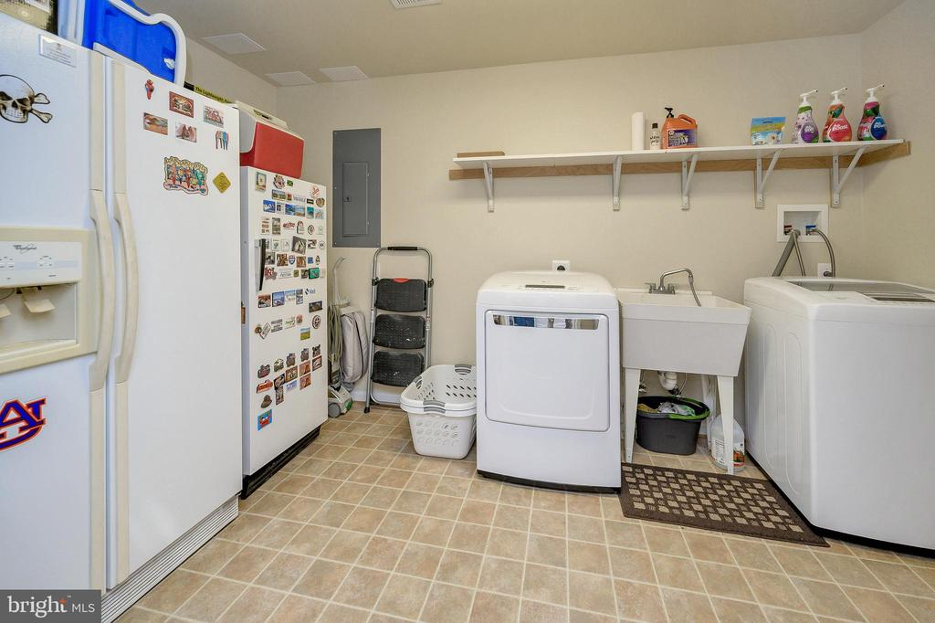 Laundry room is large enough for storage as well. - 200 SAND TRAP LN, LOCUST GROVE