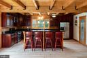 Enjoy the bar height kitchen island - 33150 HUMMINGBIRD LN, LOCUST GROVE