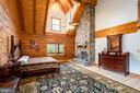 Master suite, cathedral ceilings, stone fireplace - 33150 HUMMINGBIRD LN, LOCUST GROVE