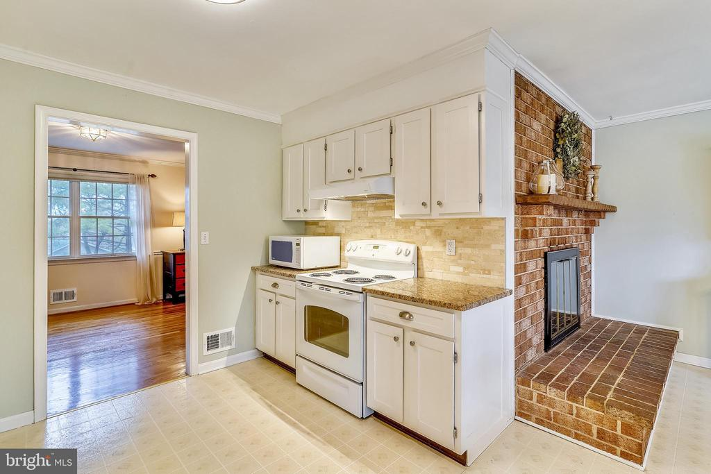 Another View of Kitchen & 2-sided Fireplace - 24624 RIDGE RD, DAMASCUS