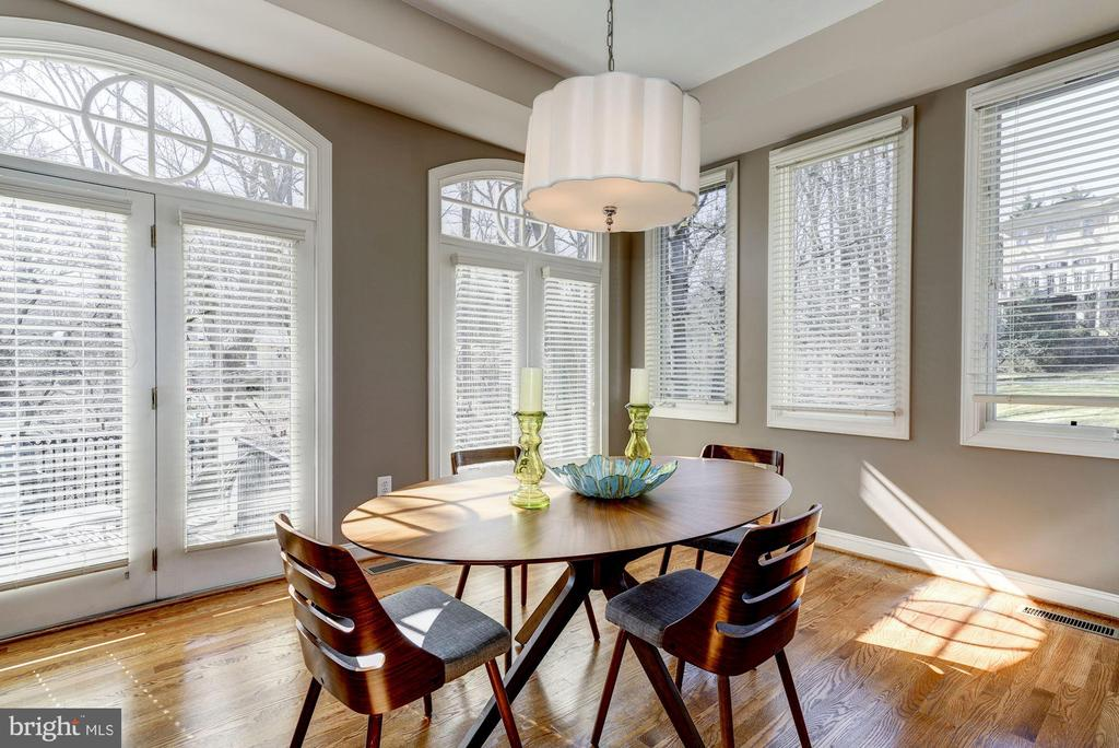 A spacious Breakfast Room with deck access - 3942 27TH RD N, ARLINGTON