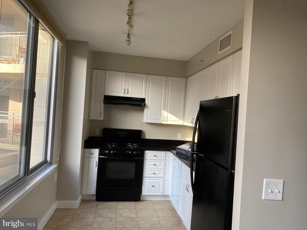 New Black granite counter and backsplash - 555 MASSACHUSETTS AVE NW #202, WASHINGTON