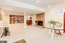 Lower level recreation room w/ wood fireplace. - 11726 WINTERWAY LN, FAIRFAX STATION